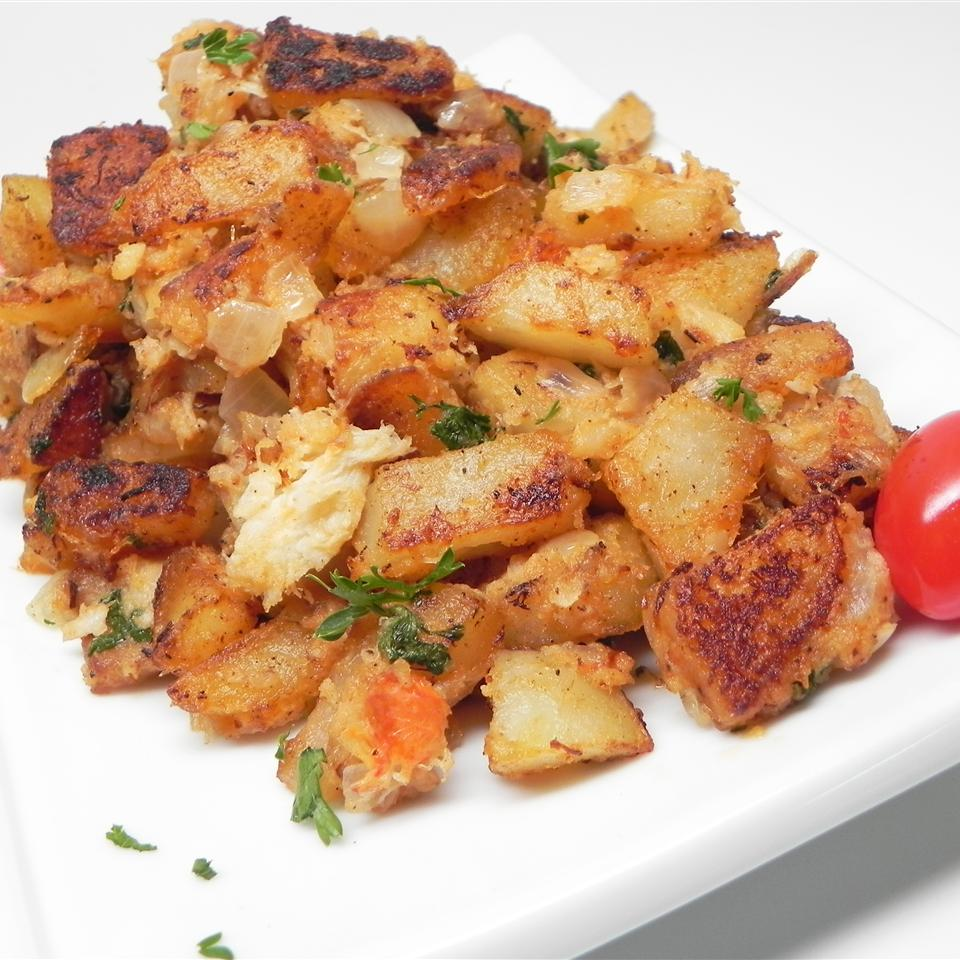 potato hash with crab meat on white plate