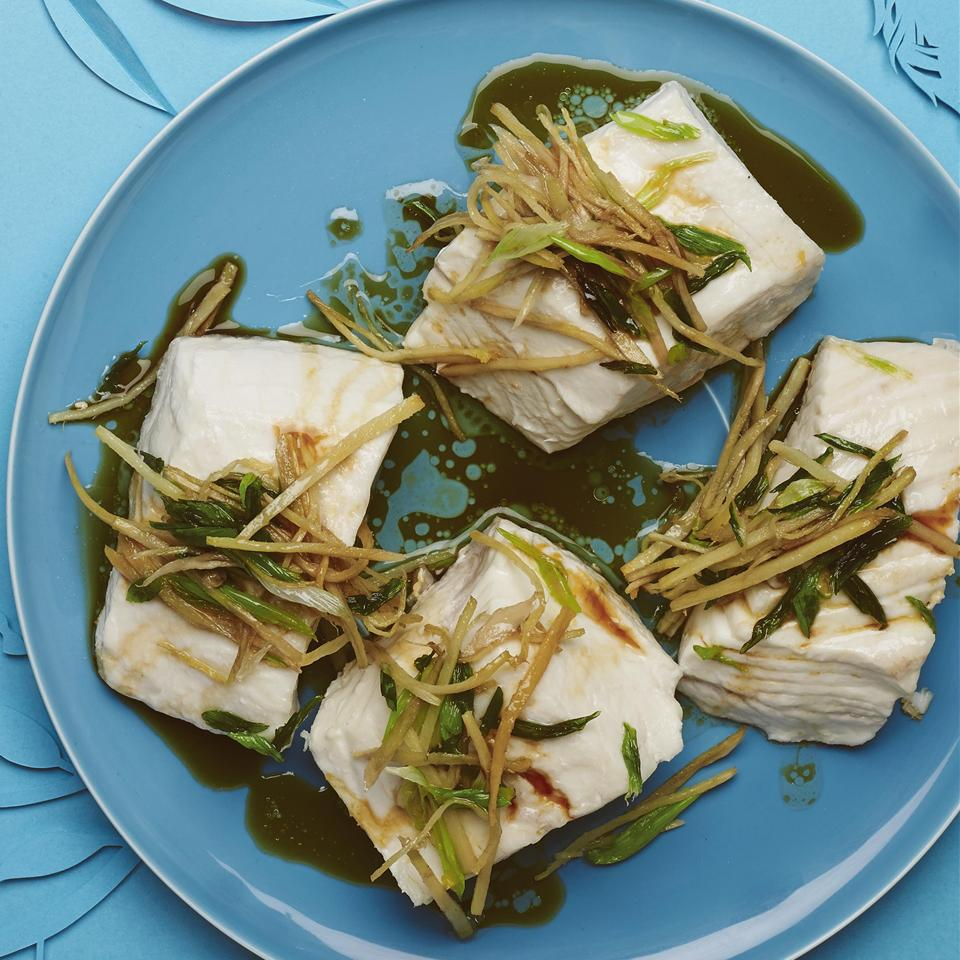 Authentic Chinese Steamed Fish on a blue plate