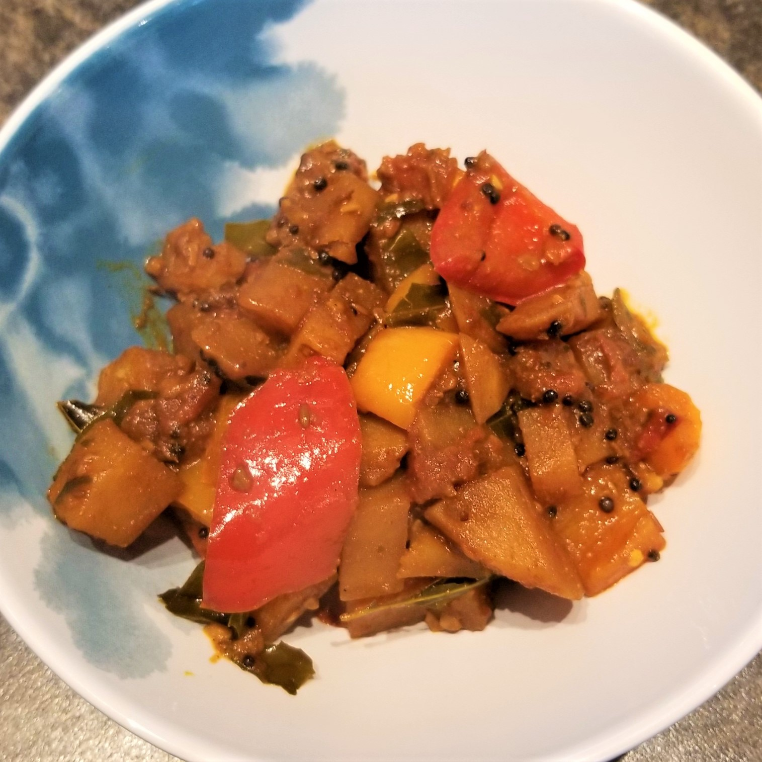 a bowl with a bell pepper and potato curry