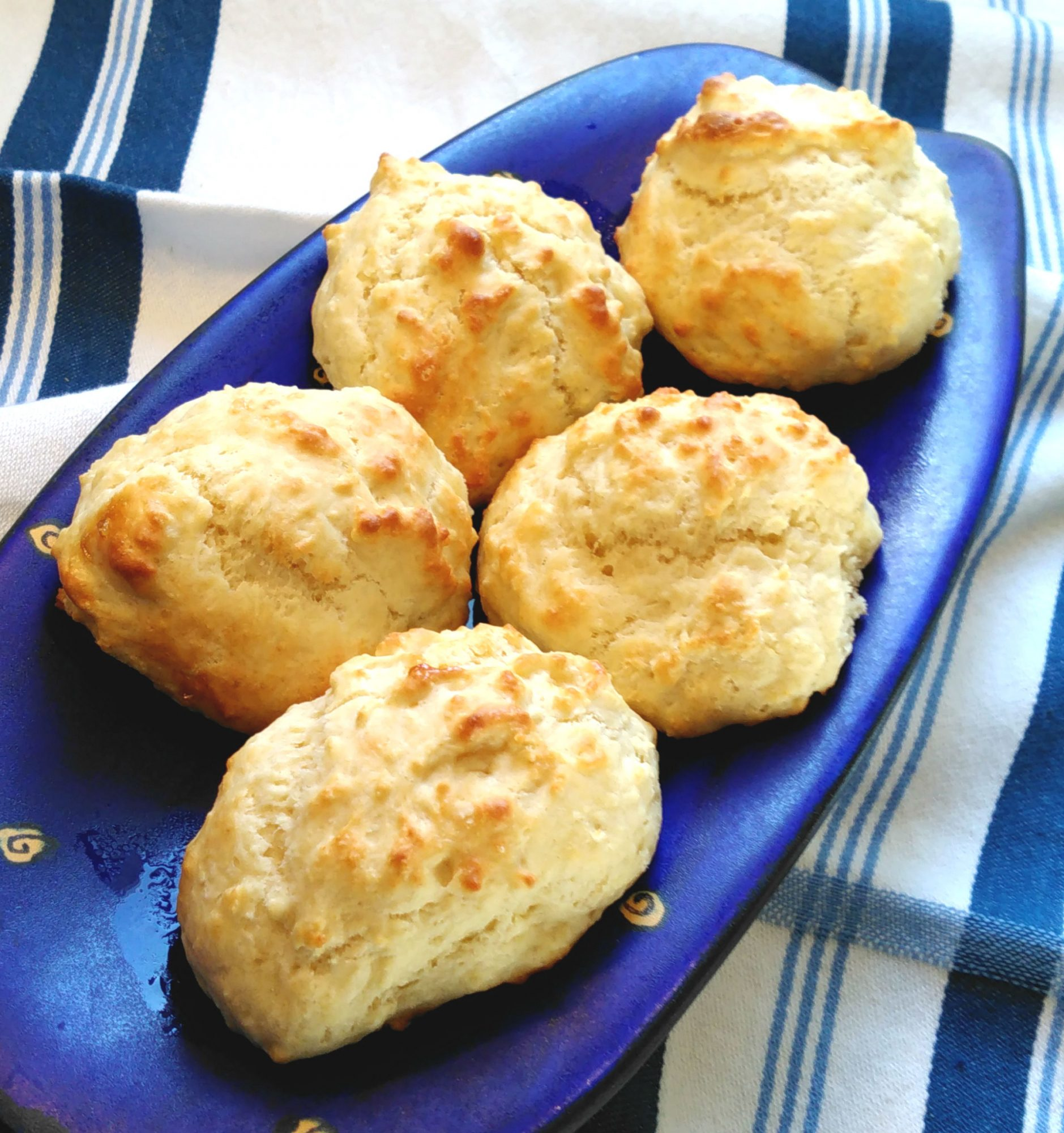 homemade drop biscuits on a blue plate