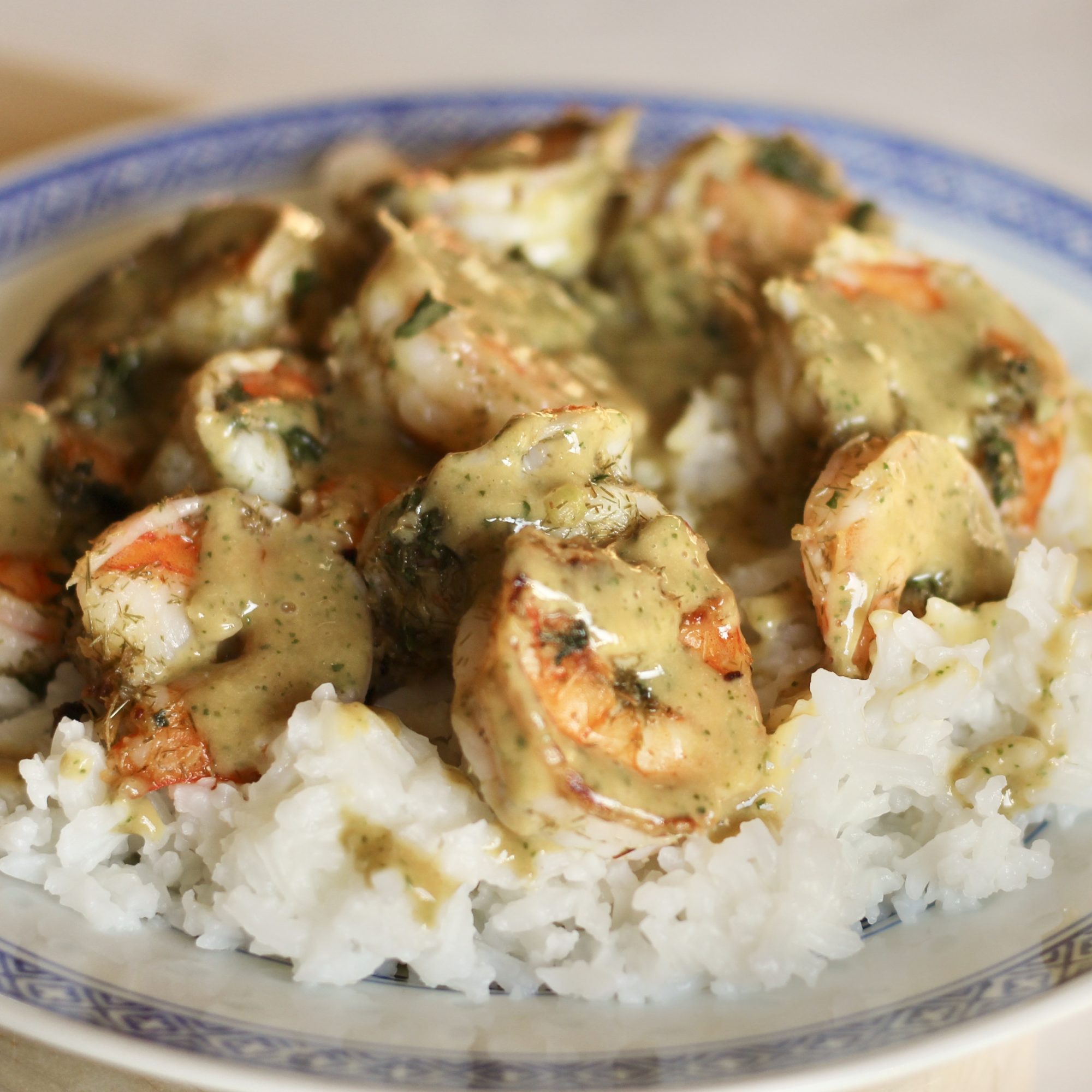 grilled prawns with sauce over rice