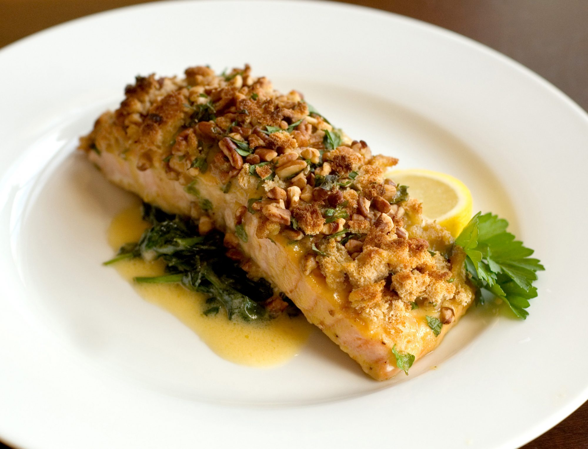 salmon with cream sauce and pecan topping