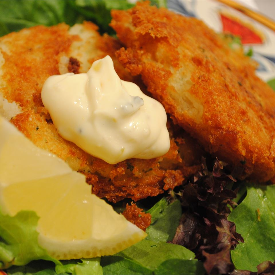 fried fish with tartar sauce and lemon wedge