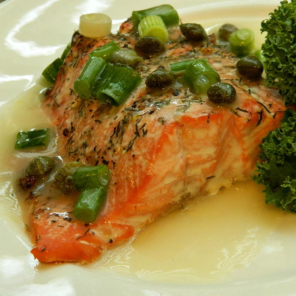 salmon fillet with white sauce and green onions