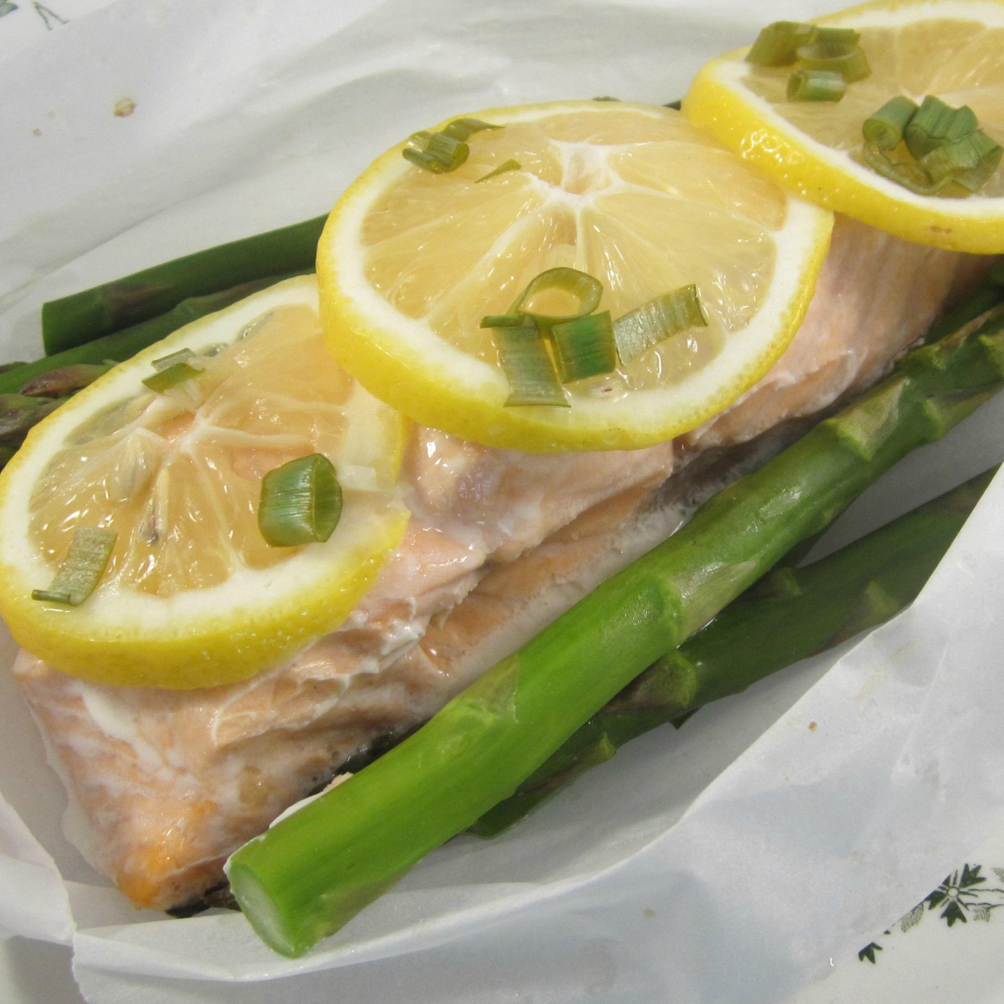 salmon fillet with lemon and asparagus in parchment paper