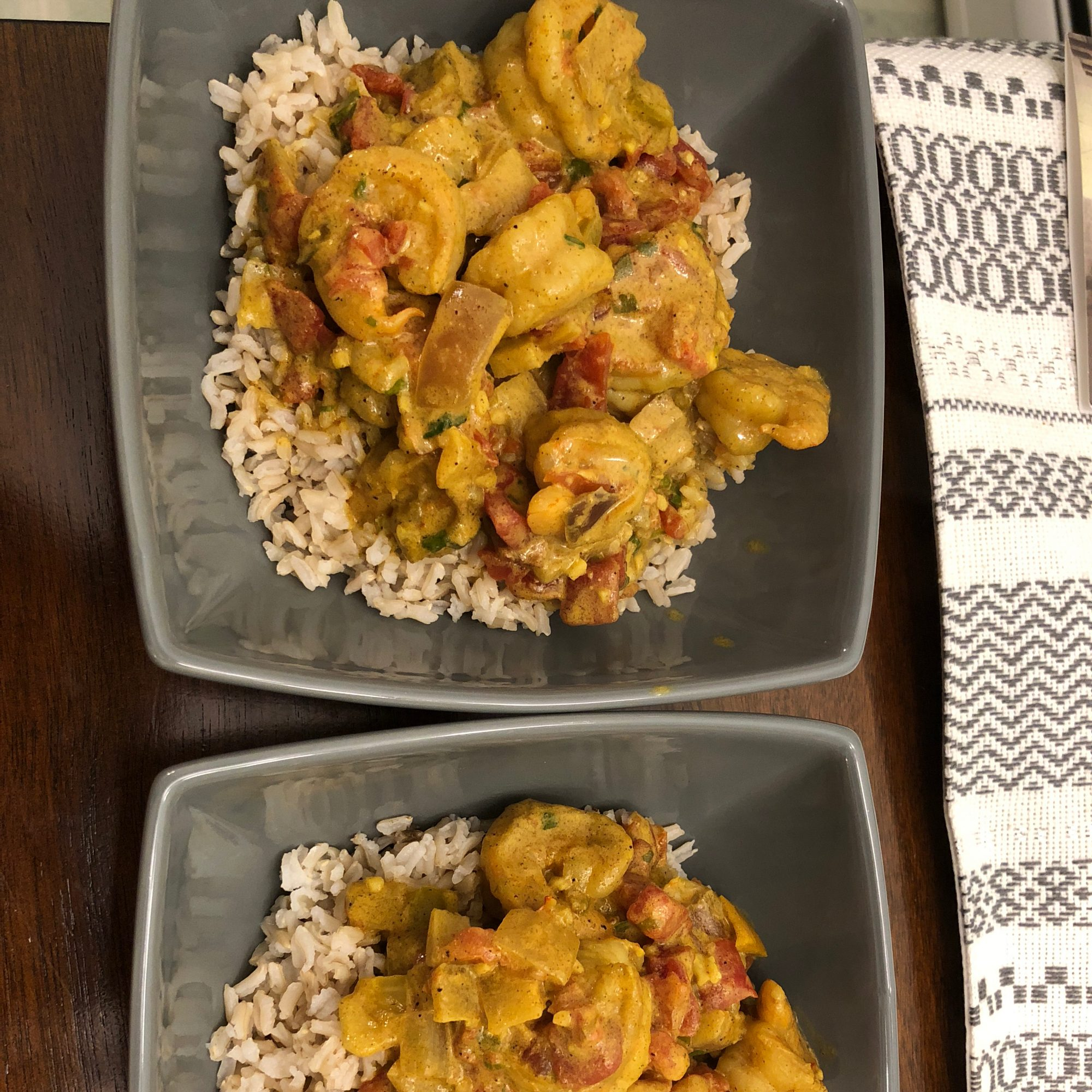 shrimp and clam curry over rice in bowls