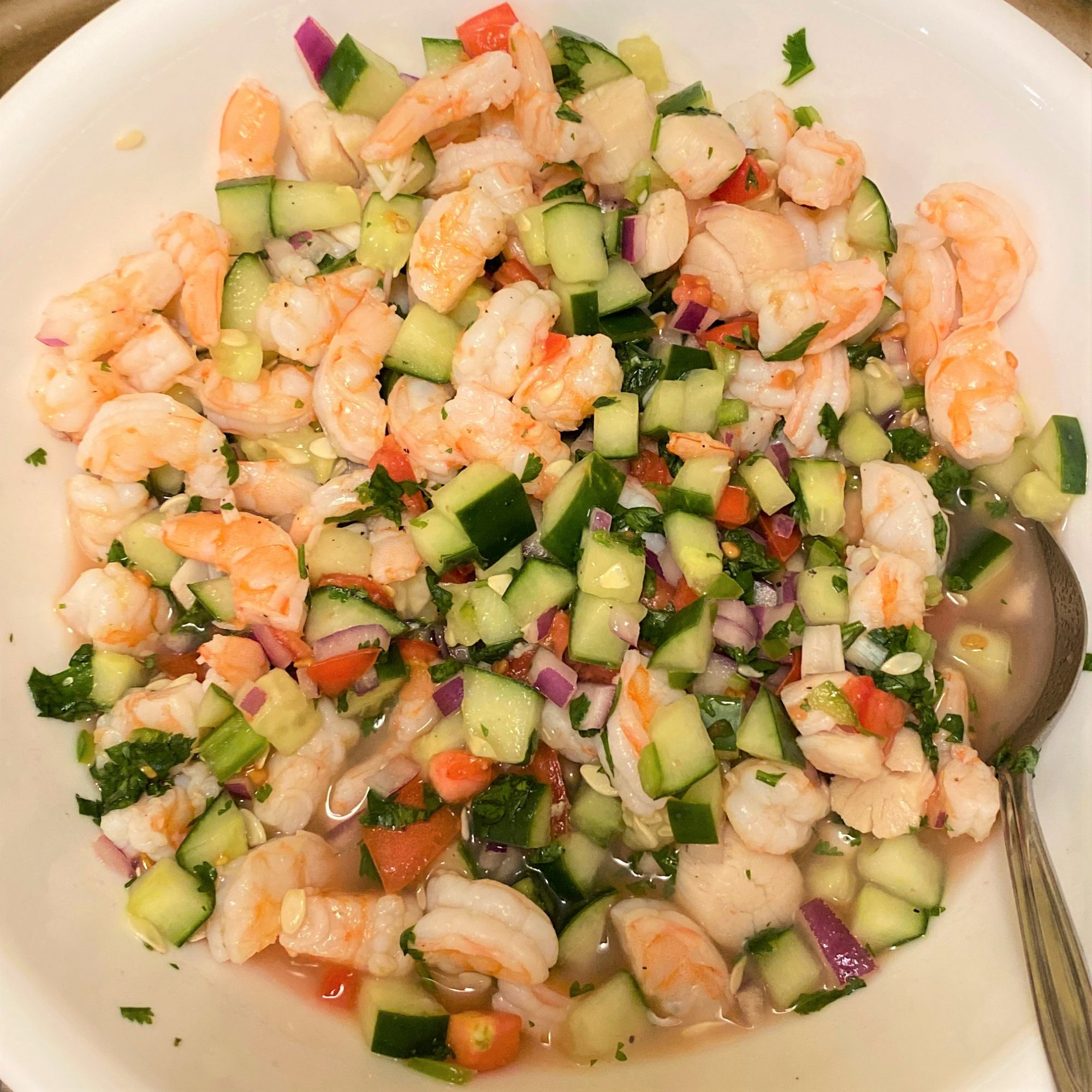 cooked shrimp ceviche in a white bowl