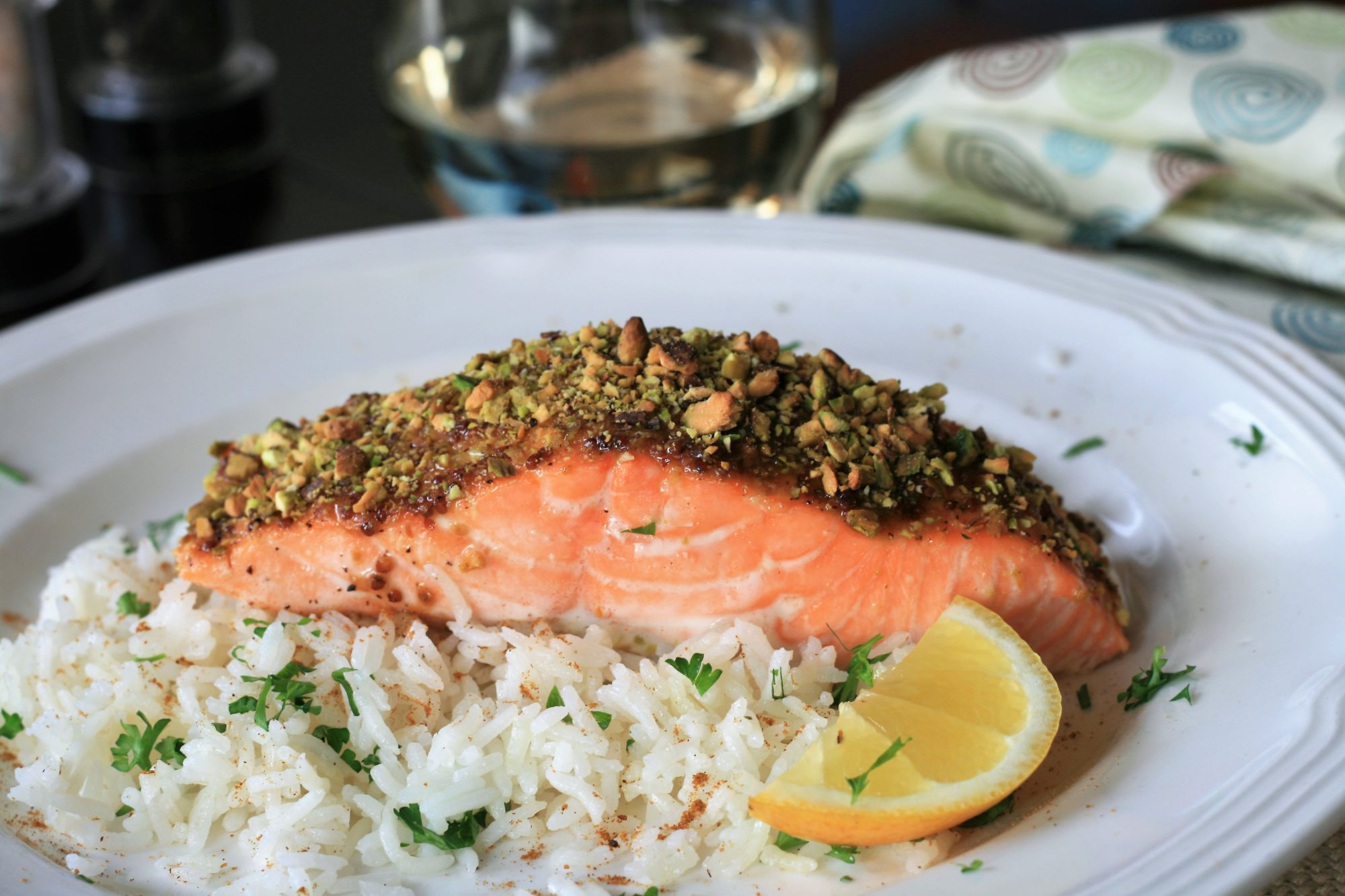 salmon filet with crushed pistachios over rice