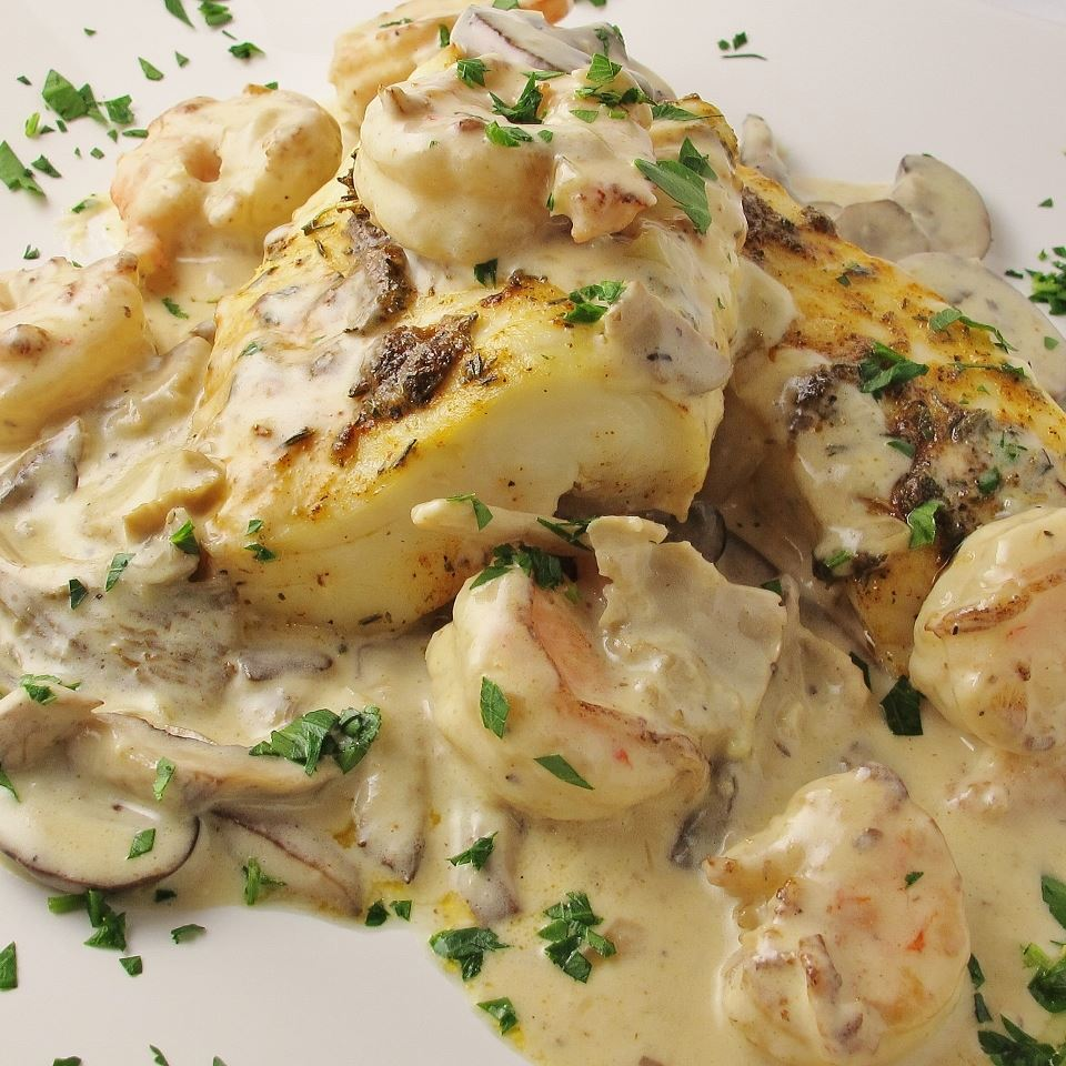 fish and shrimp with cream sauce and mushrooms