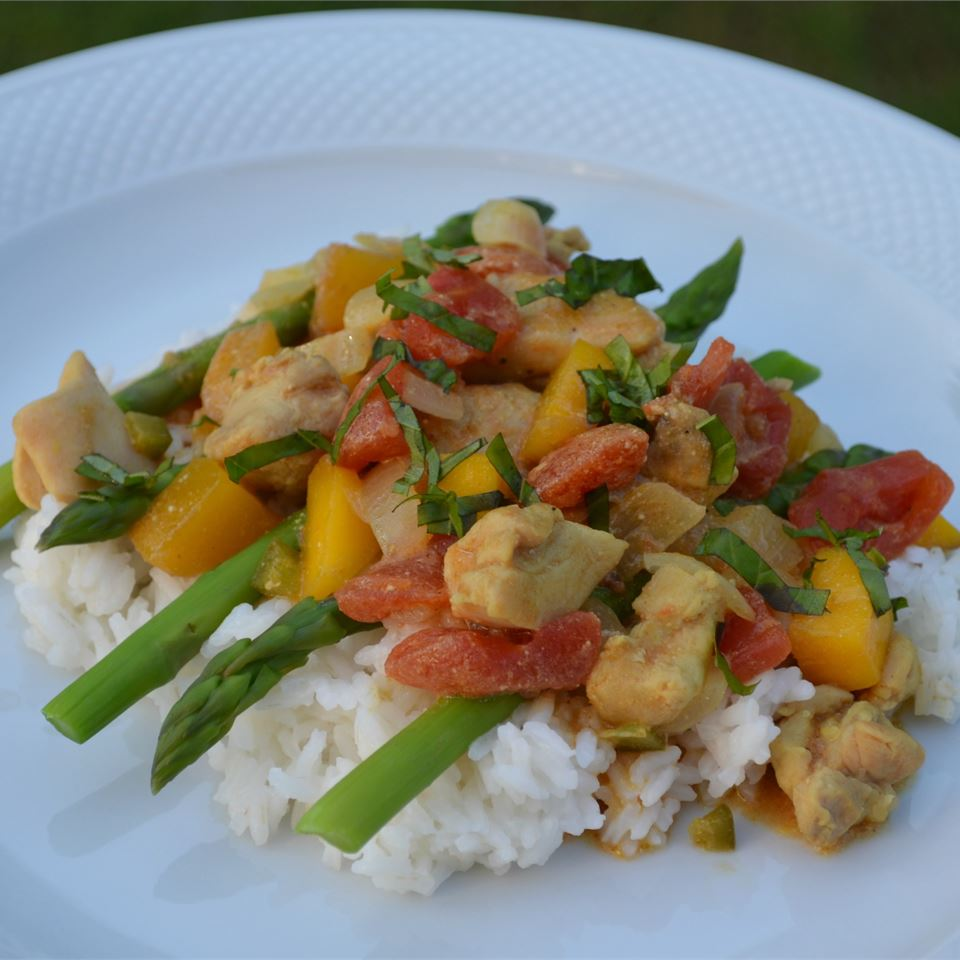 chicken with mango salsa and asparagus over rice