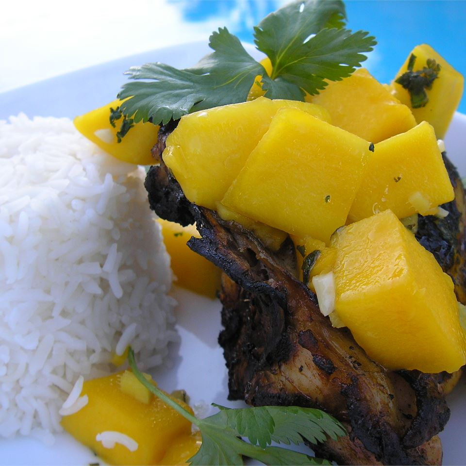 mango over grilled chicken with cilantro and white rice