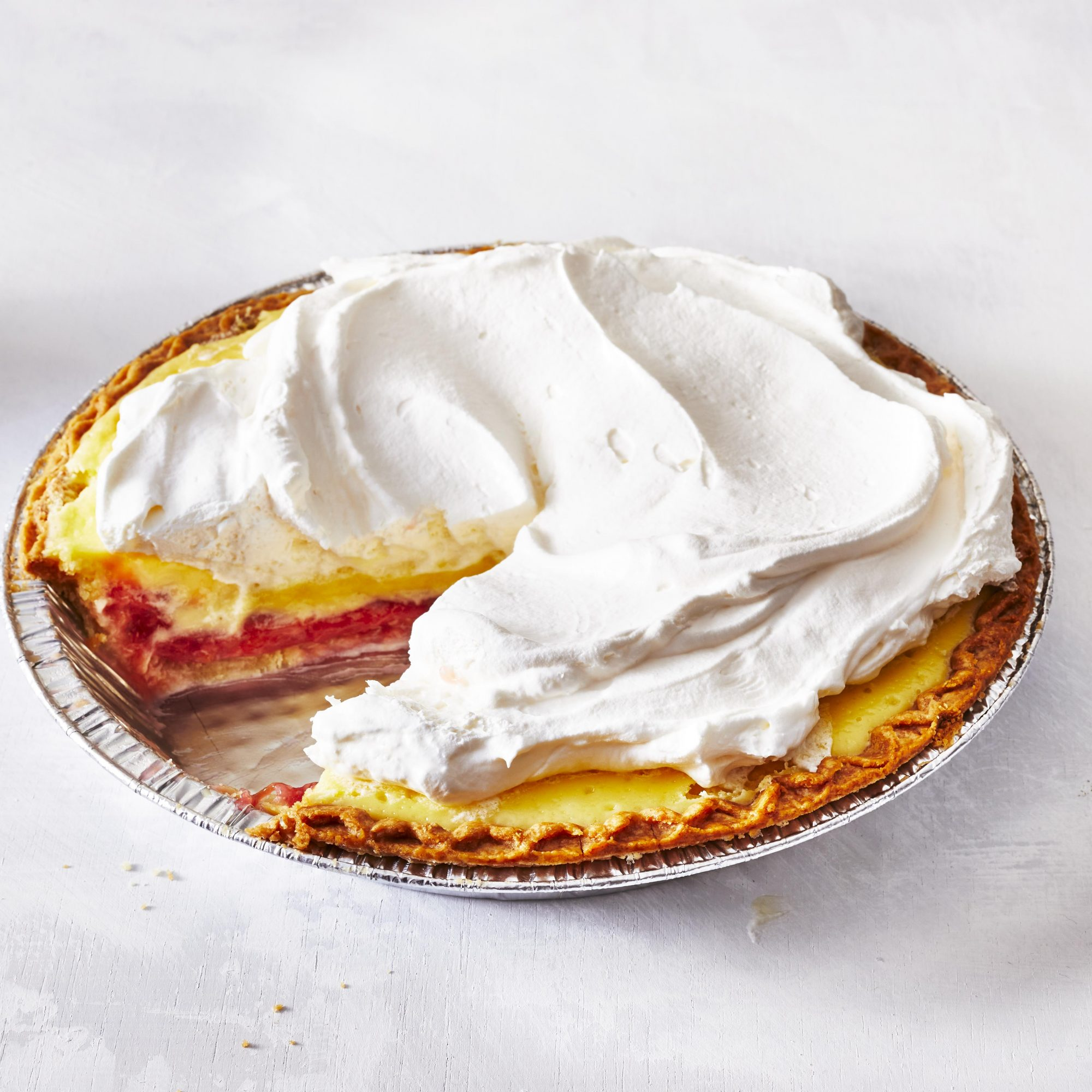 rhubarb cheesecake pie with whipped cream topping
