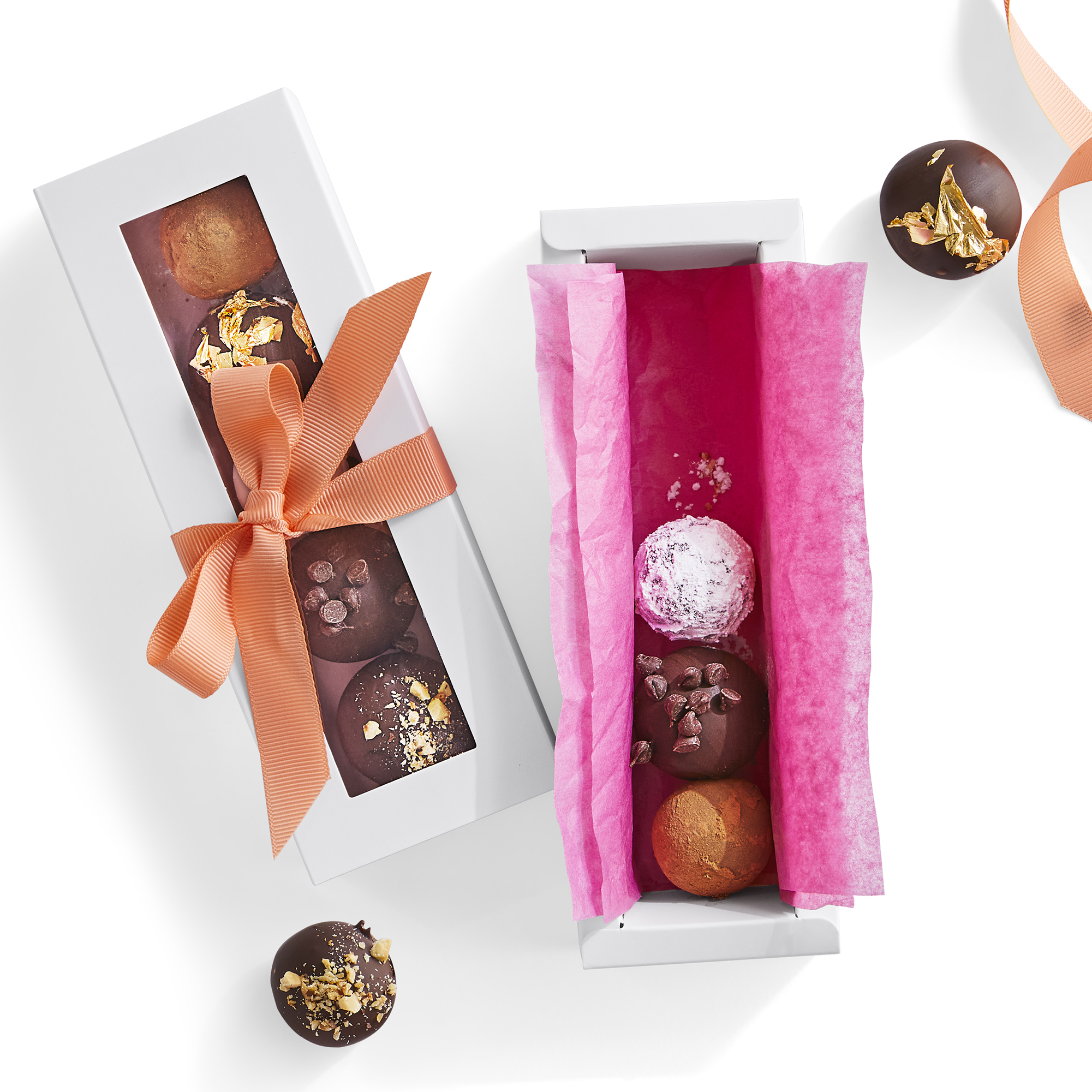 Two small boxed packaged with Twilight Dark Chocolate truffles, for gifting