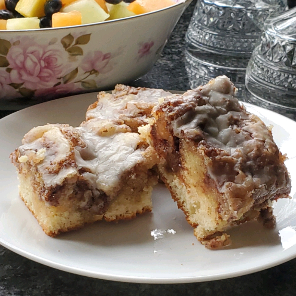 two slices of cinnamon roll cake on a plate