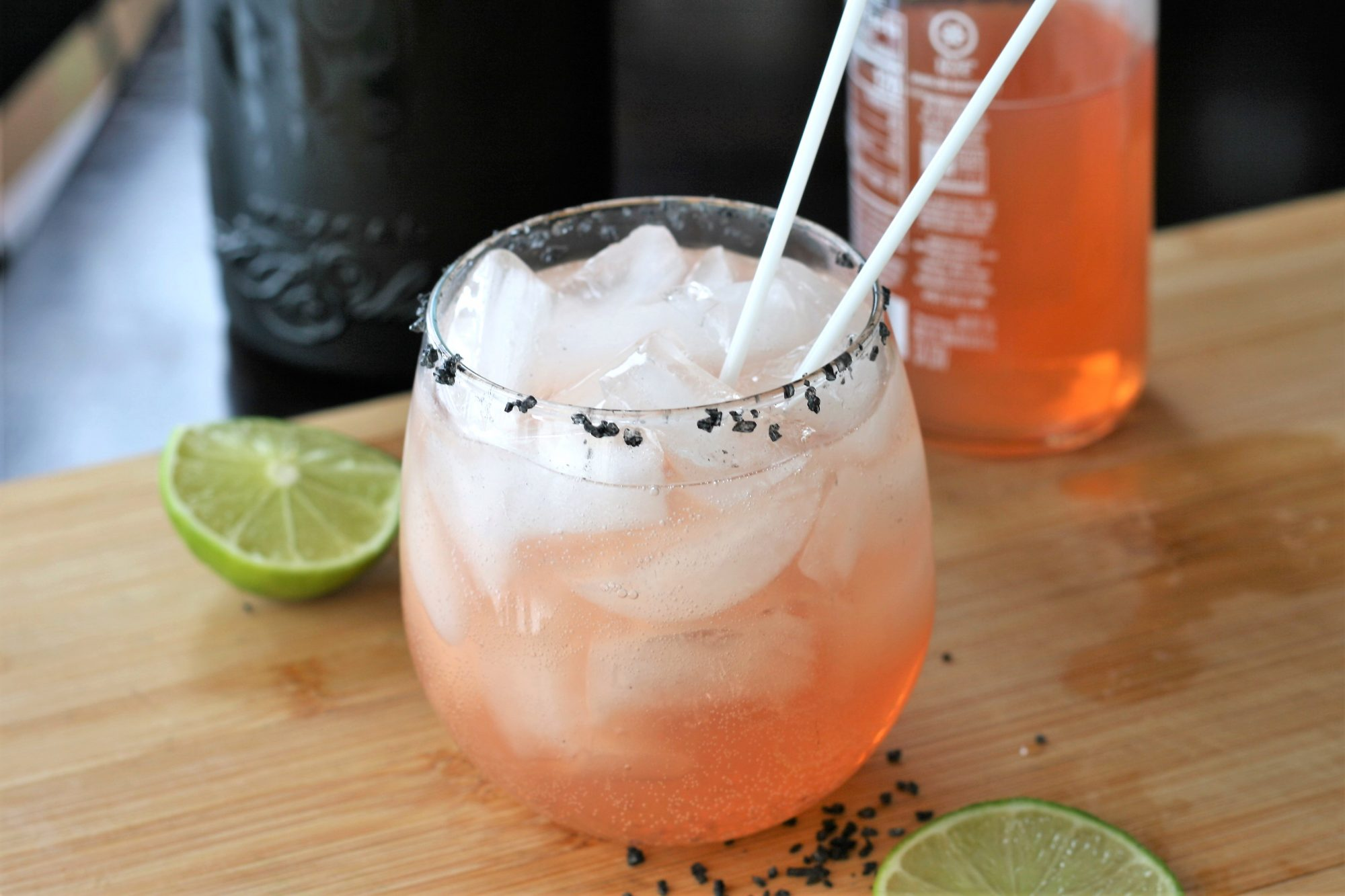 paloma in a glass with ice and straws
