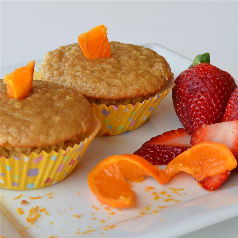 A recipe for delicate oatmeal muffins with the delightful tang of orange. Juice-soaked oats combine with butter, vanilla, and nutmeg to create chewy, perfectly golden treats.