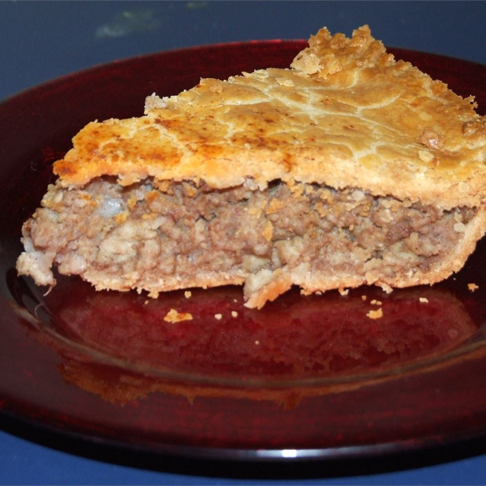 """This French-Canadian speciality is made with pork, potatoes, onions and spices. """"This is an excellent tourtiere recipe. I have been making tourtieres for 46 years and this is great. I have always added some garlic and I don't think the egg and paprika are necessary because the fat in the pork makes the crust brown,"""" writes reviewer Patricia E."""