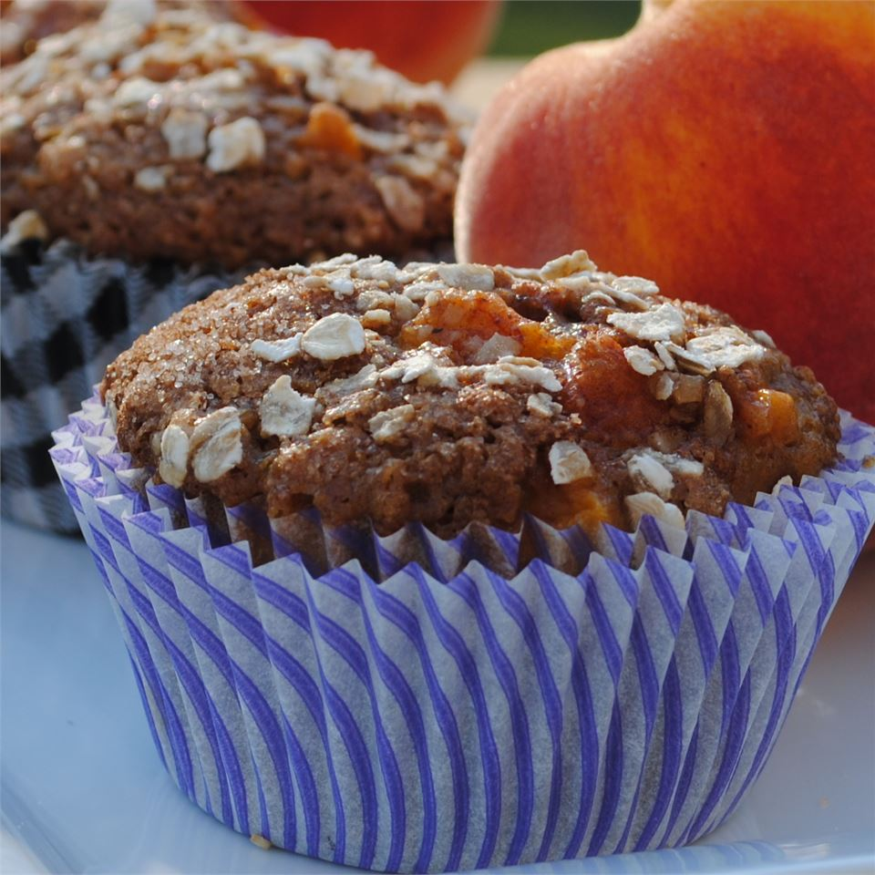 Rich, fragrant muffins dotted with fresh diced peaches. Brown sugar, buttermilk, applesauce, and oatmeal ensure a moist, flavorful texture.
