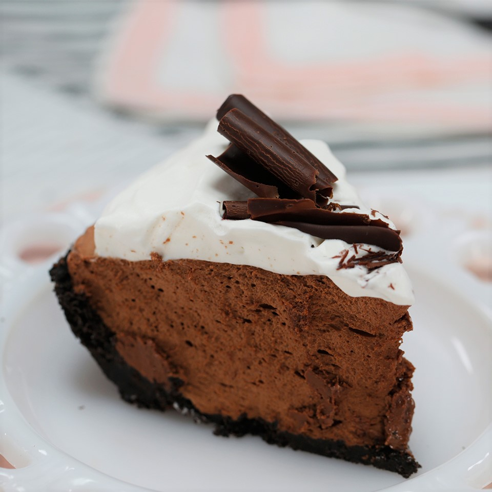 """We hear banana cream pie is the Minnesota state pie, but that doesn't stop residents of the Gopher State from searching out this over-the-top chocolate pie option. The beauty of this recipe from creator Smart Cookie is that it's no-bake. (But it does require a six-hour wait in the fridge.) """"This recipe is just like the original 1951 recipe. (Well, except for the coffee) I make this pie at least once a year. I have never used the cookie crust but will certainly give it a try,"""" writes reviewer Janet Greenwell."""