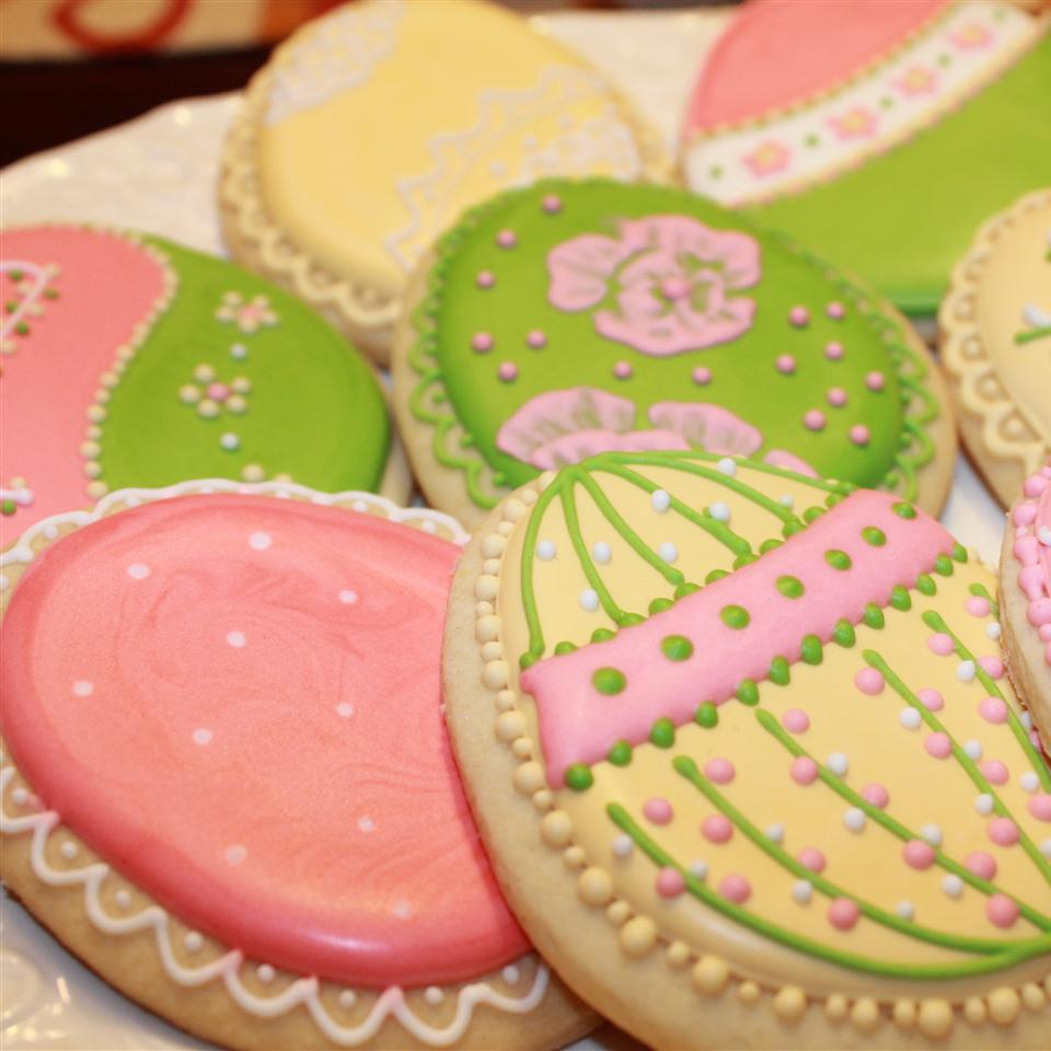 egg-shaped cookies intricately decorated with pastel-colored icing to look like Easter eggs