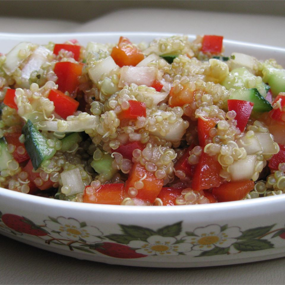quinoa with peppers and cucumbers in dish