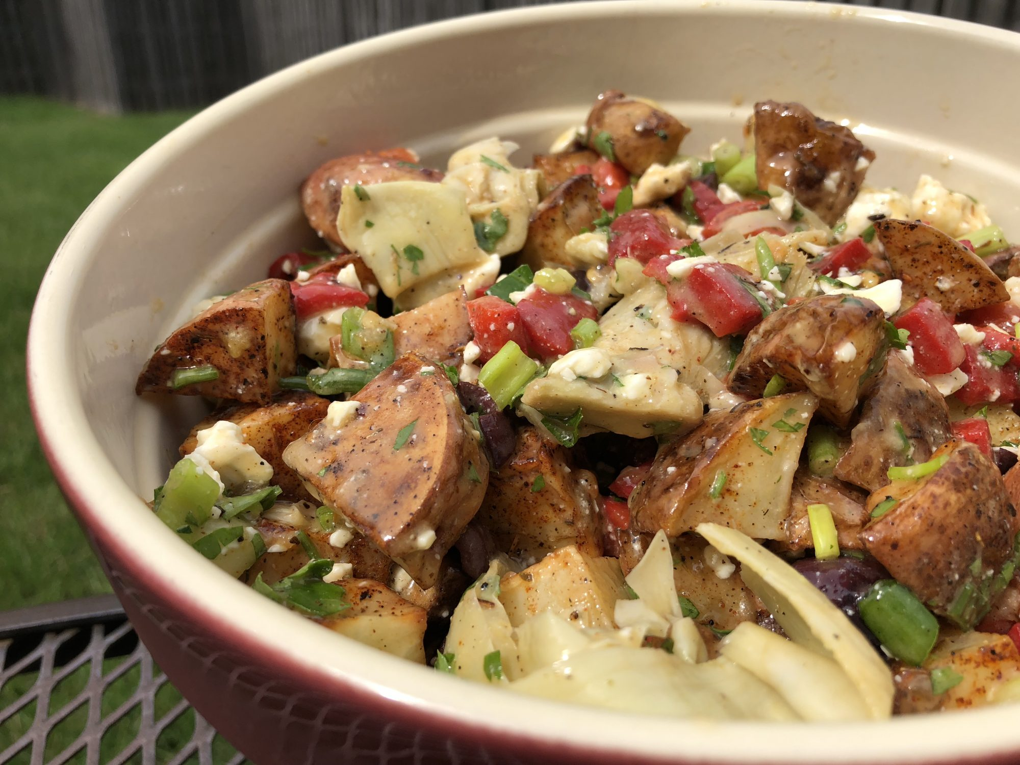 roasted potatoes with green onions, peppers, and artichokes