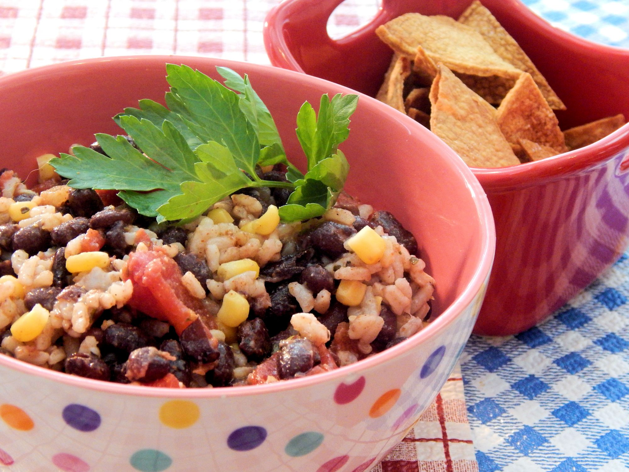 bean salad with rice, corn, and tomatoes in bowl