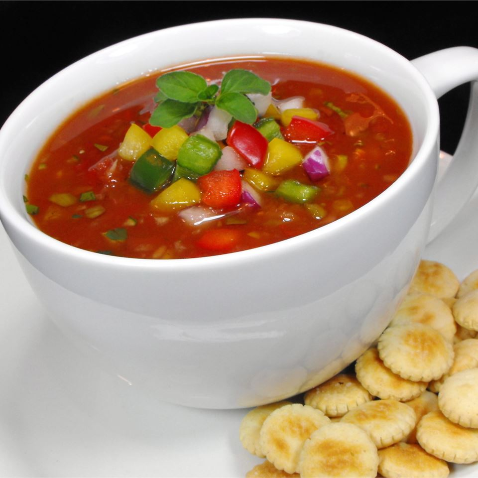 gazpacho in cup with pepper garnish and oyster crackers on the side