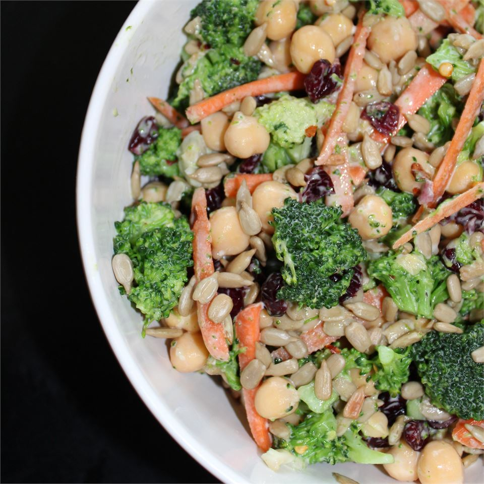 broccoli salad with pine nuts, carrots, chickpeas, and dried cranberries
