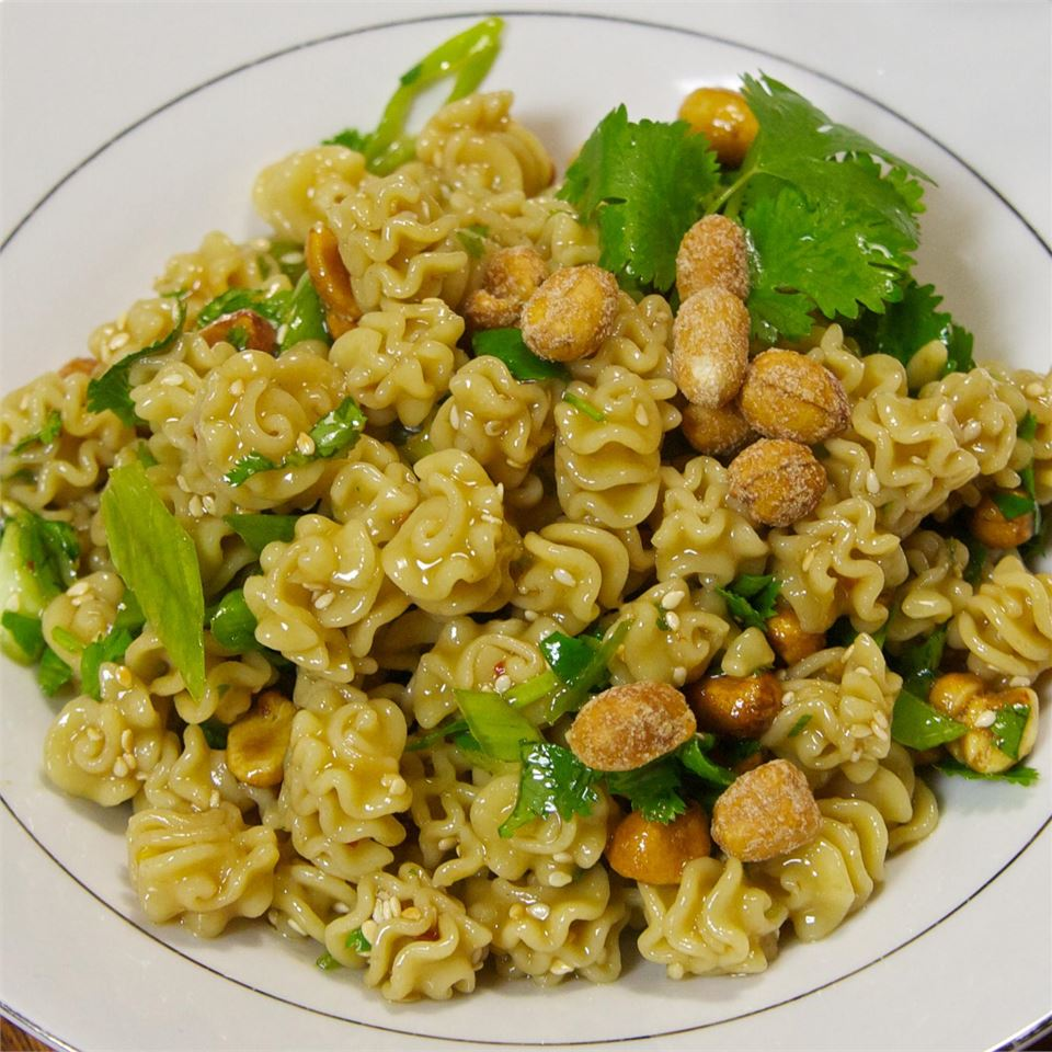 pasta with sauce, peanuts, and parsley