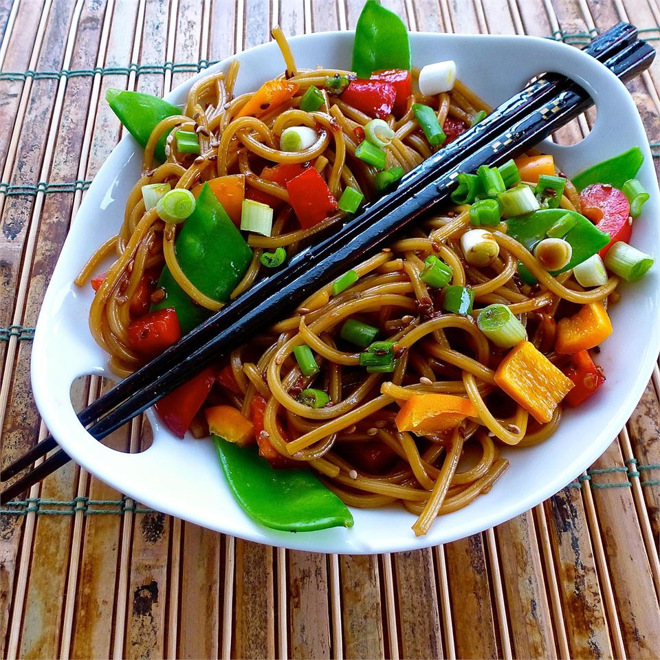 noodles and veggies in sauce with chopstiks