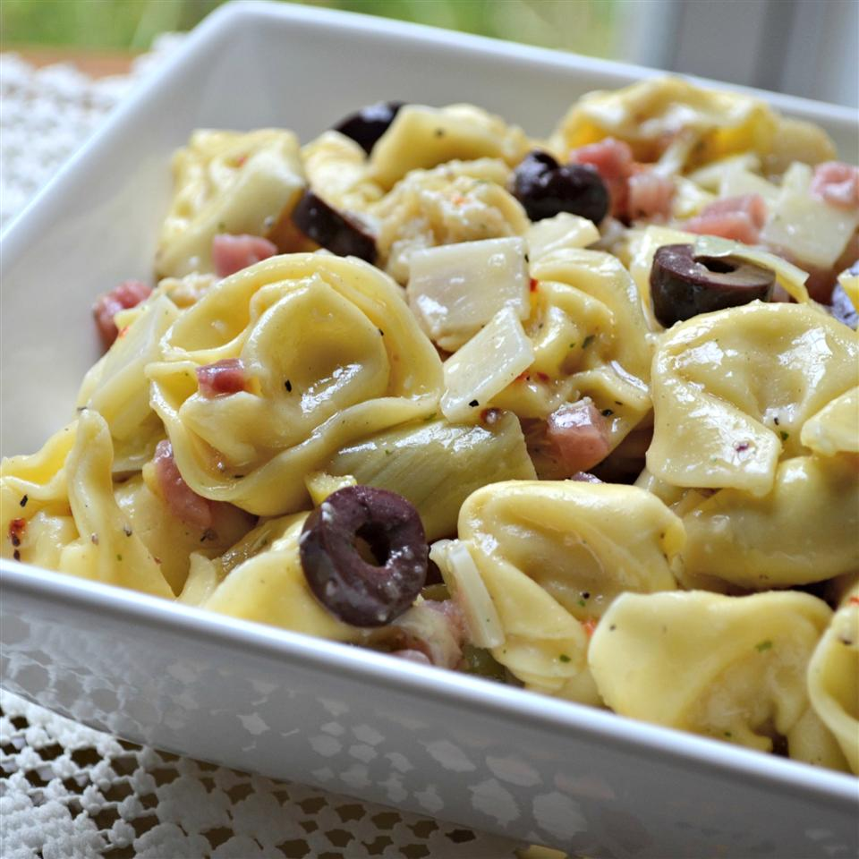 cheese tortellini salad with olives and artichokes
