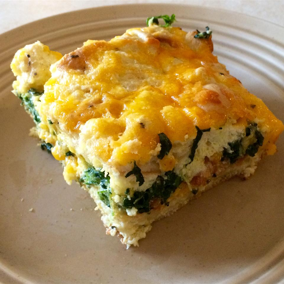 square of bacon, cheddar, and spinach strata