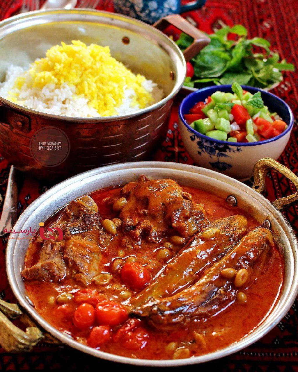 Khoresht Bademjoumn eggplant stew with shirazi salad and vegetables