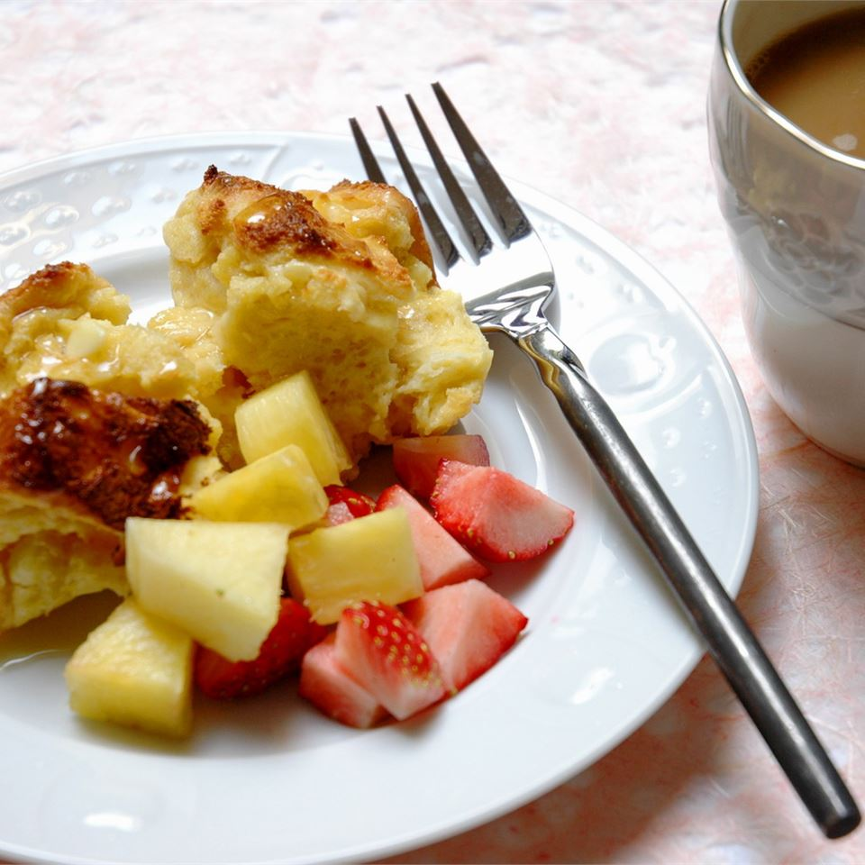 French toast souffle served with fresh strawberries and pineapple