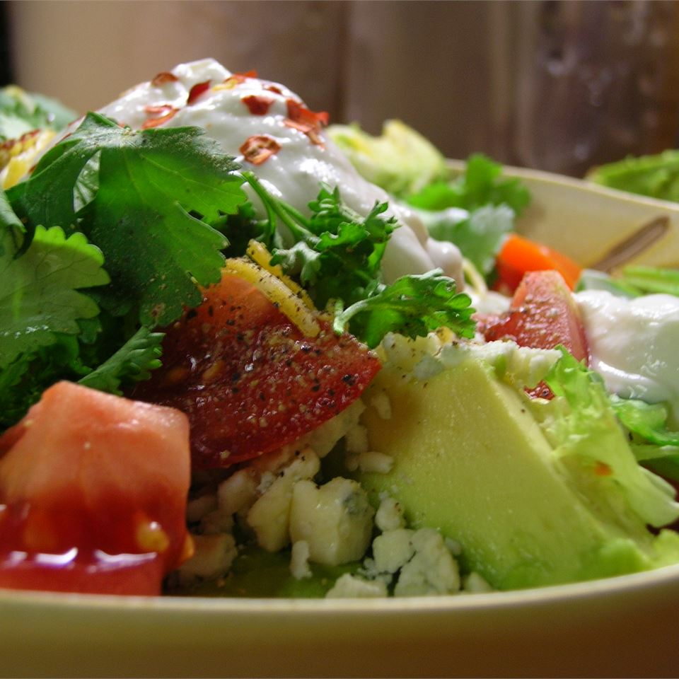 salad with avocado, tomatoes, and blue cheese