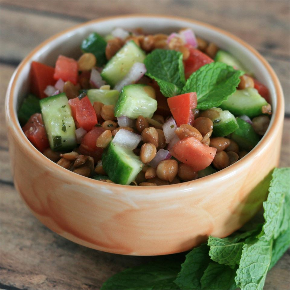cucumbers, tomatoes, lentils, and mint in small bowl