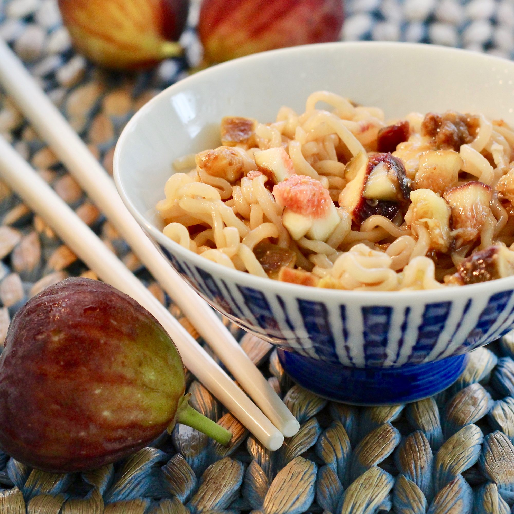 ramen noodles with fresh figs and chopsticks