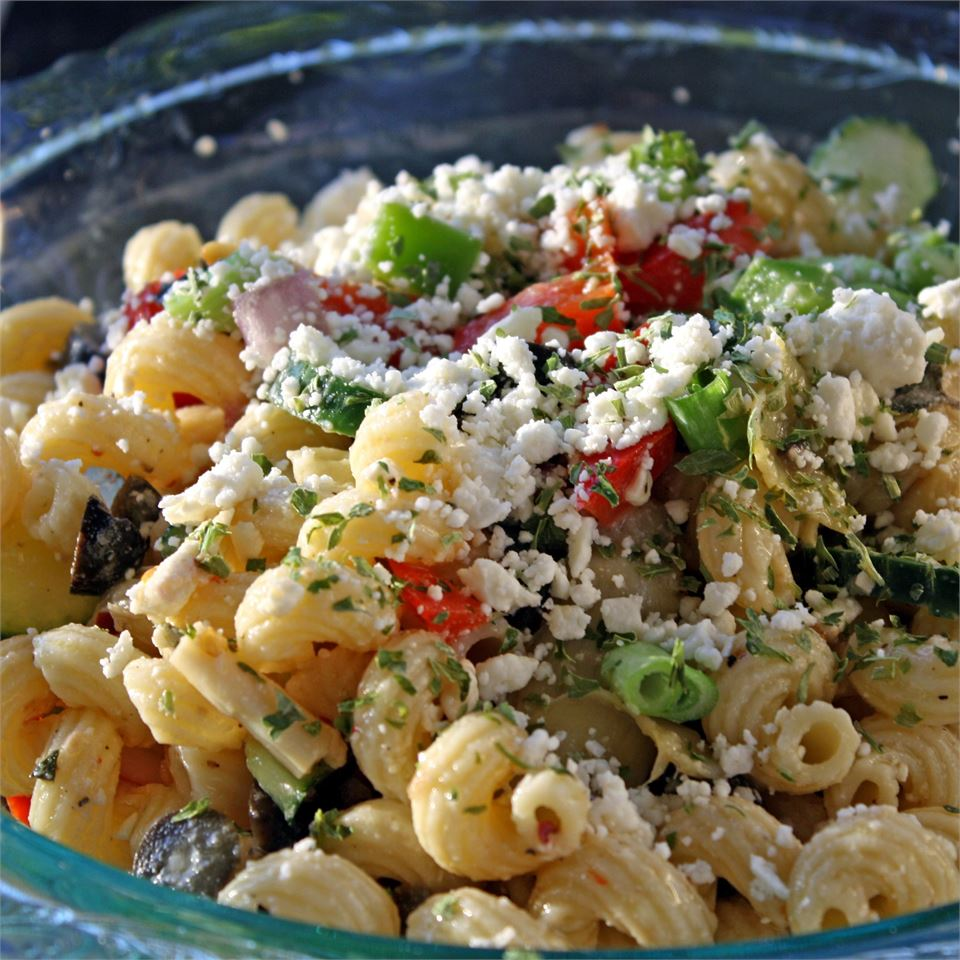 bowl of greek pasta salad with olives, peppers, and feta cheese
