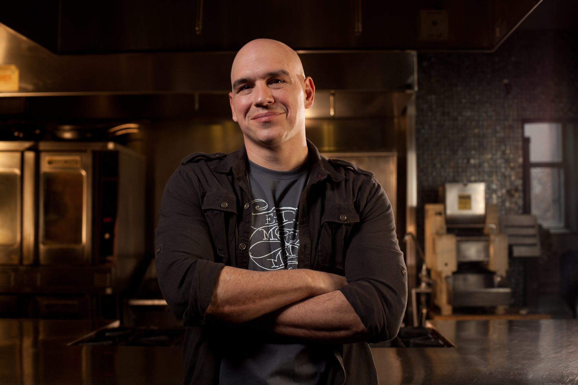 headshot of Michael Symon with arms crossed