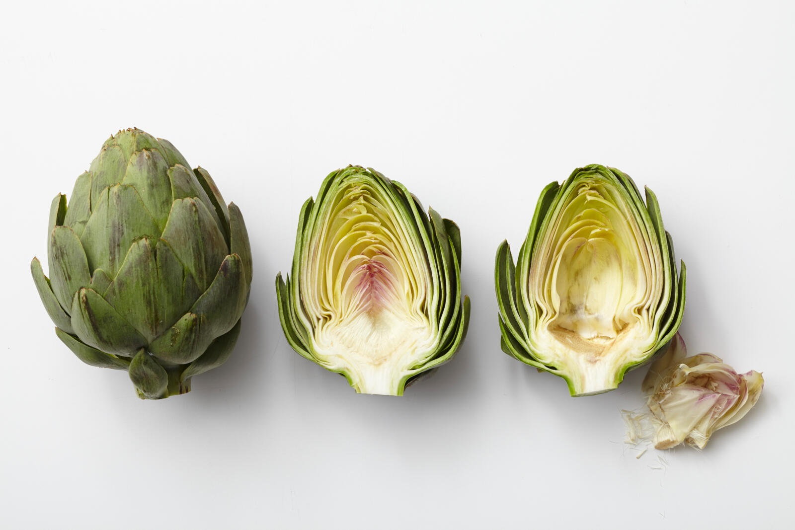 fresh artichokes whole and cut in half lengthwise