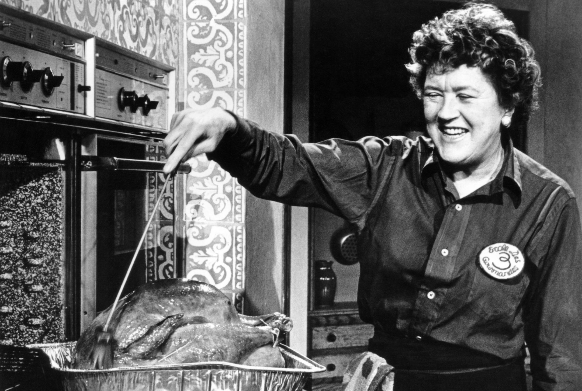 Julia Child in the kitchen with poultry