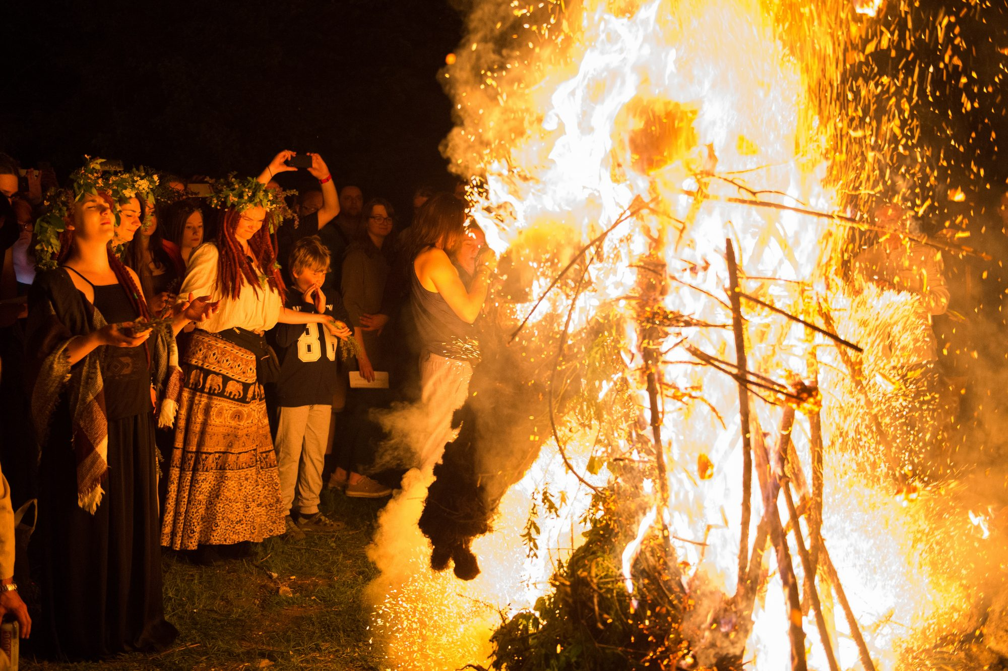 Participants participate in a ritual during the Beltane