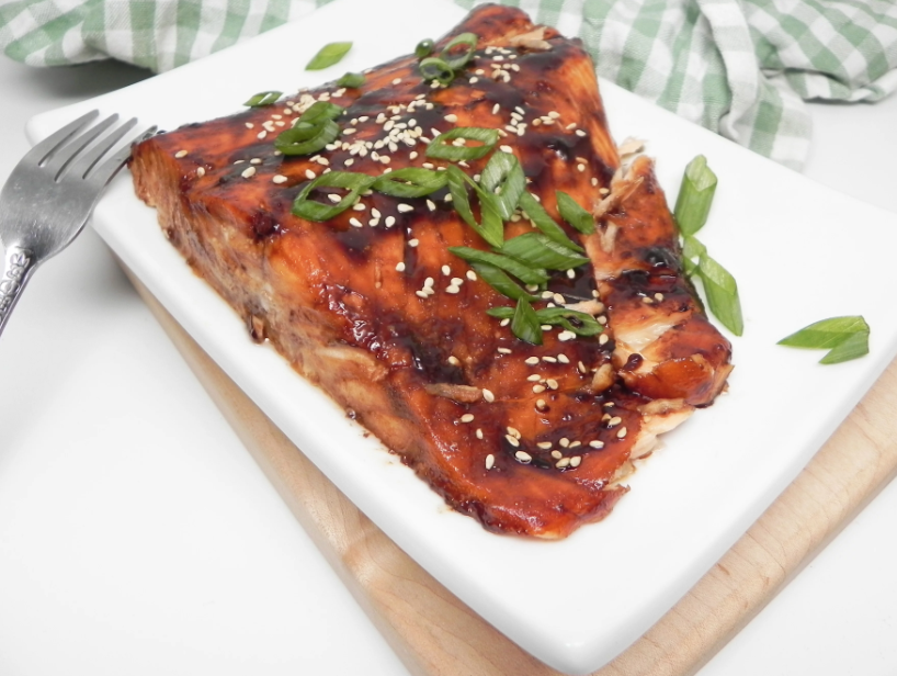 A homemade teriyaki glaze — made with cornstarch, soy sauce, brown sugar, sesame oil, and garlic — sticks to the fish without running onto the plate. Top with green onions and toasted sesame seeds for a restaurant-worthy meal.