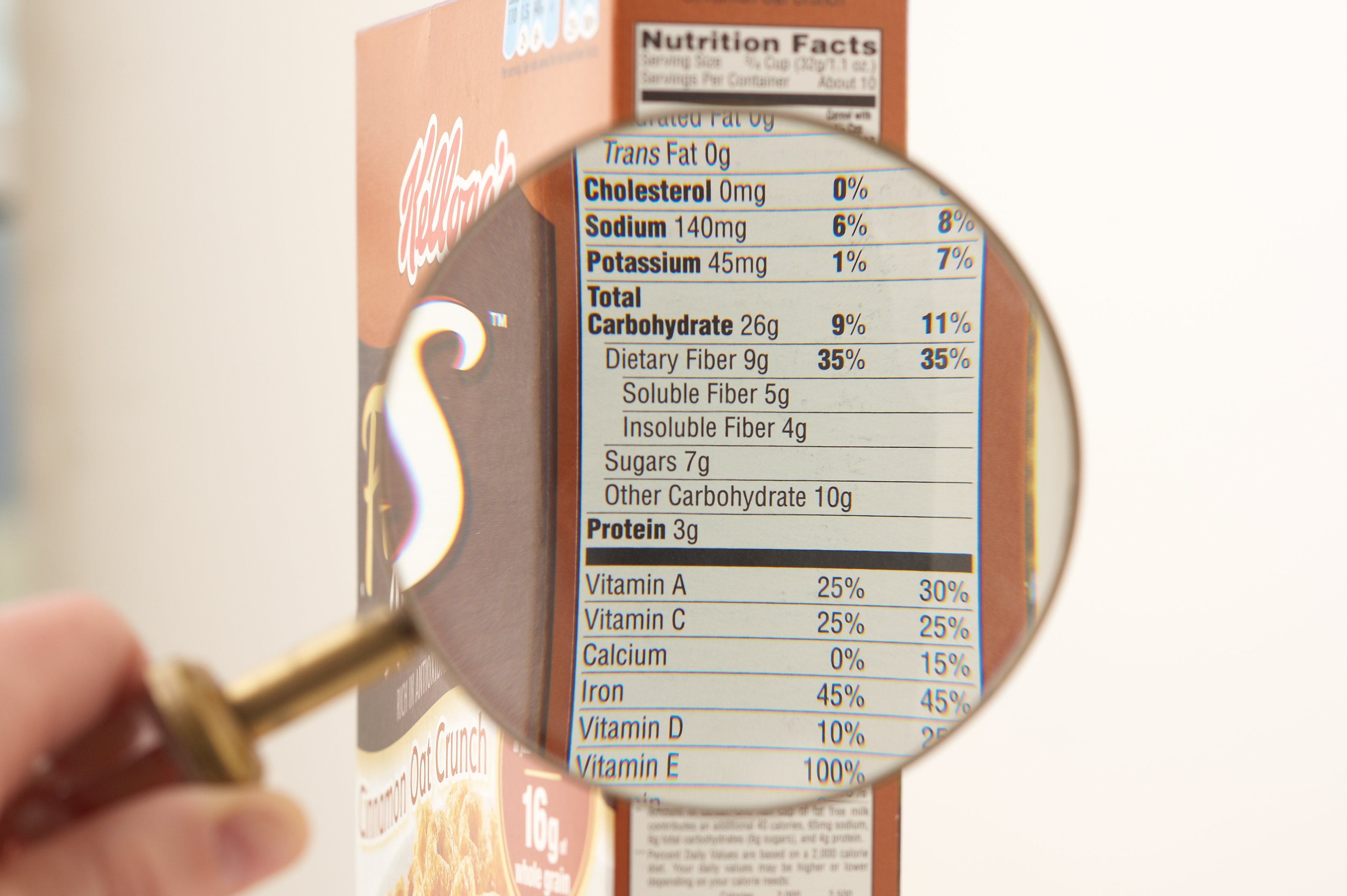a magnifying glass is over a nutritional label for closer inspection