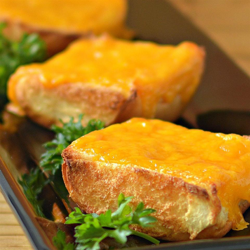 rolls with melted cheese and parsley on platter
