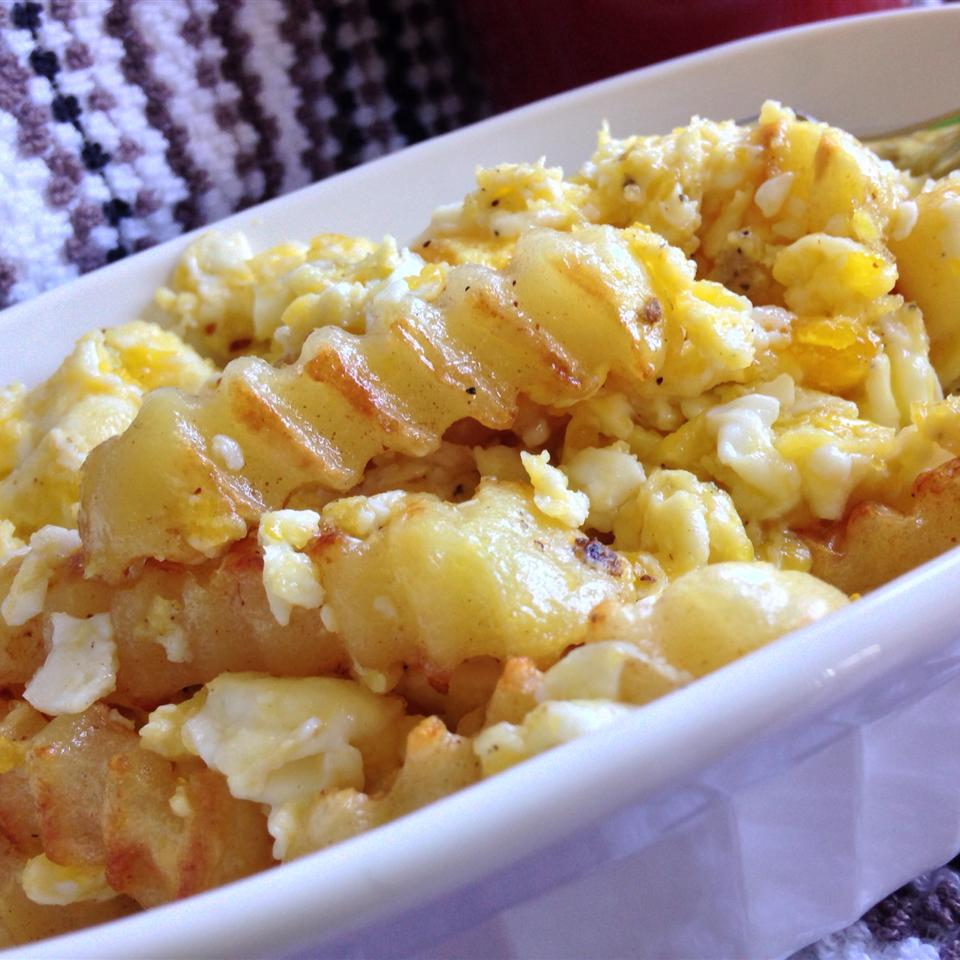 french fries and scrambled eggs in dish