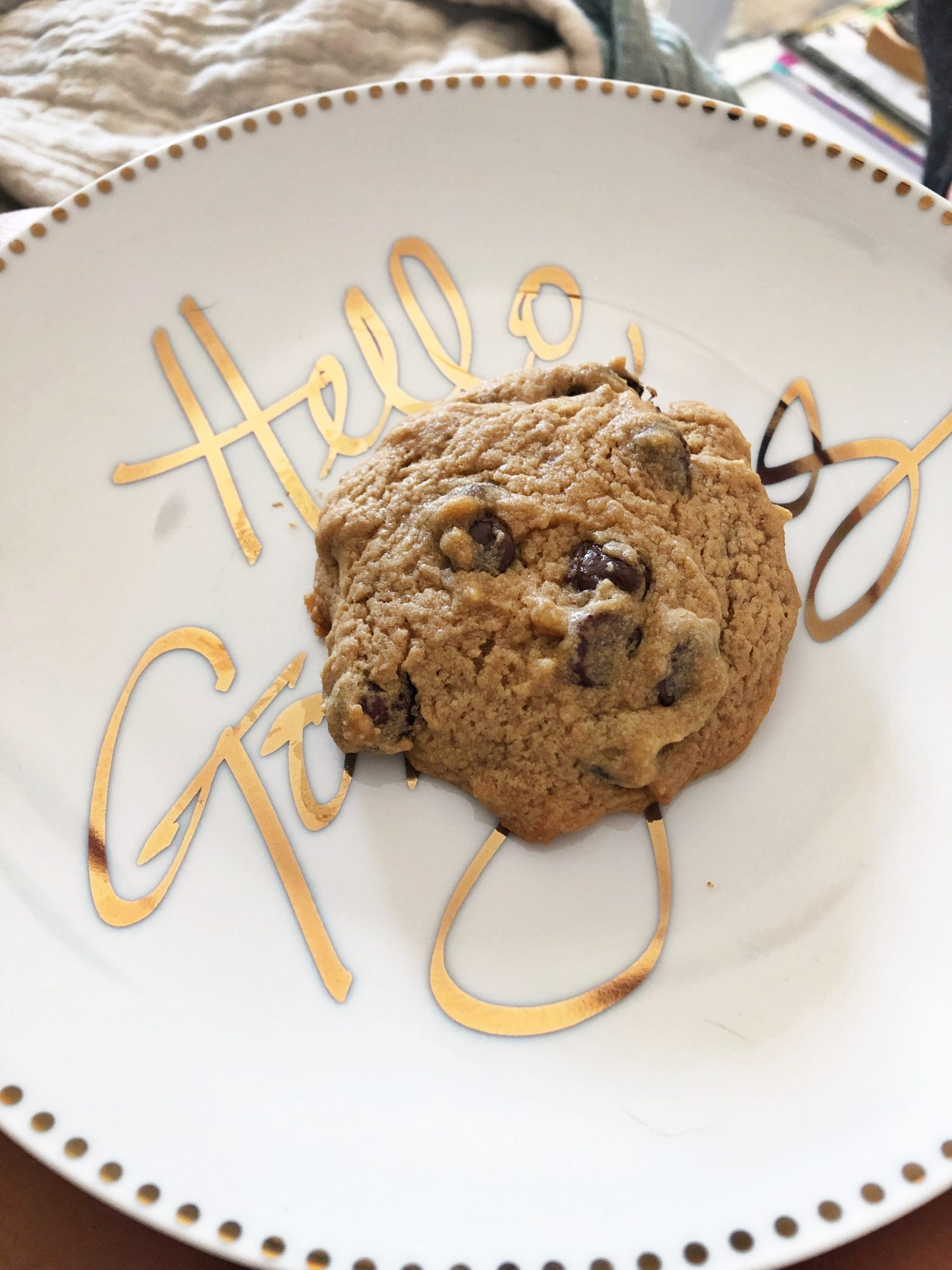 chocolate chip cookie on white and gold plate