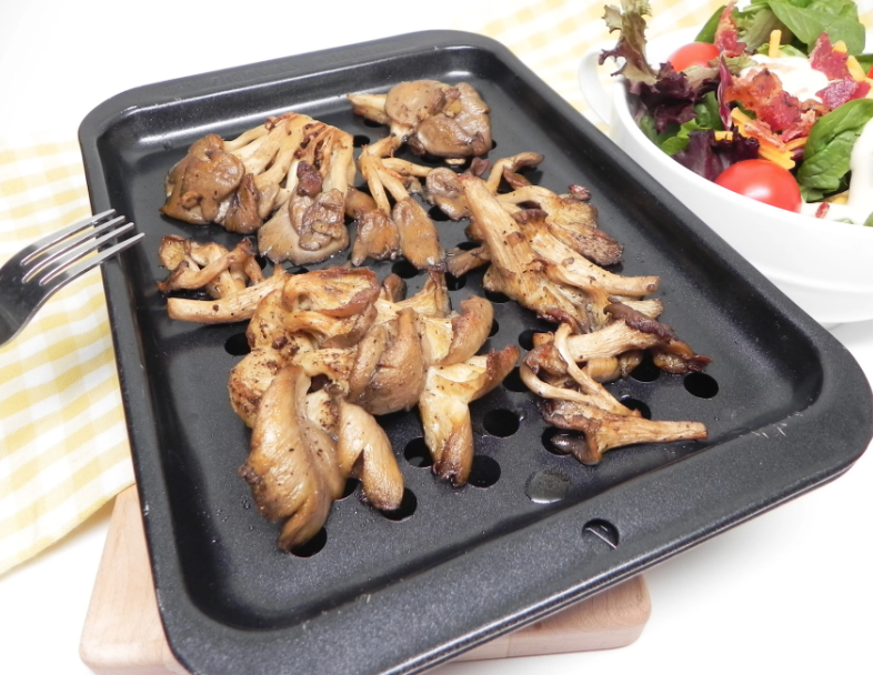 You only need four ingredients to make this basic roasted mushroom recipe: oyster mushrooms, olive oil, salt, and black pepper.