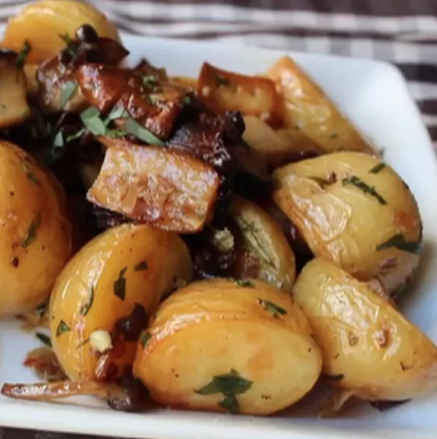 Chef Johnuses four types of mushrooms — king trumpet, chantrelle, nameko, and clamshell (shimeji) — in this roasted side dish with new potatoes.